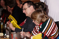 "Audience members work on their detective sheets during Mayhem & Mystery's production of ""Tragedy in the Theater"" at the Spaghetti Warehouse in downtown Dayton, Monday, February 28, 2011.  The three people who most correctly guess the who, how and why of the mystery receive a prize."