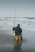 A fisherman on the town beach at Narragansett, Rhode Island.