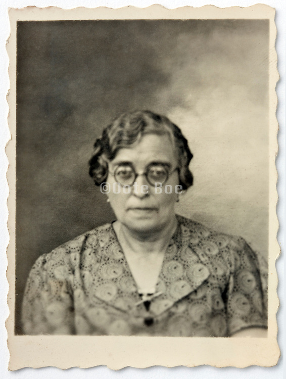 vintage identity style head and shoulder portrait of a senior woman