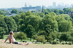 © Licensed to London News Pictures. 24/08/2016. London, UK. A man enjoys the sunshine on Primrose Hill as a mini heatwave brings sunshine and predicted temperatures above 30C in the capital. Photo credit : Stephen Chung/LNP