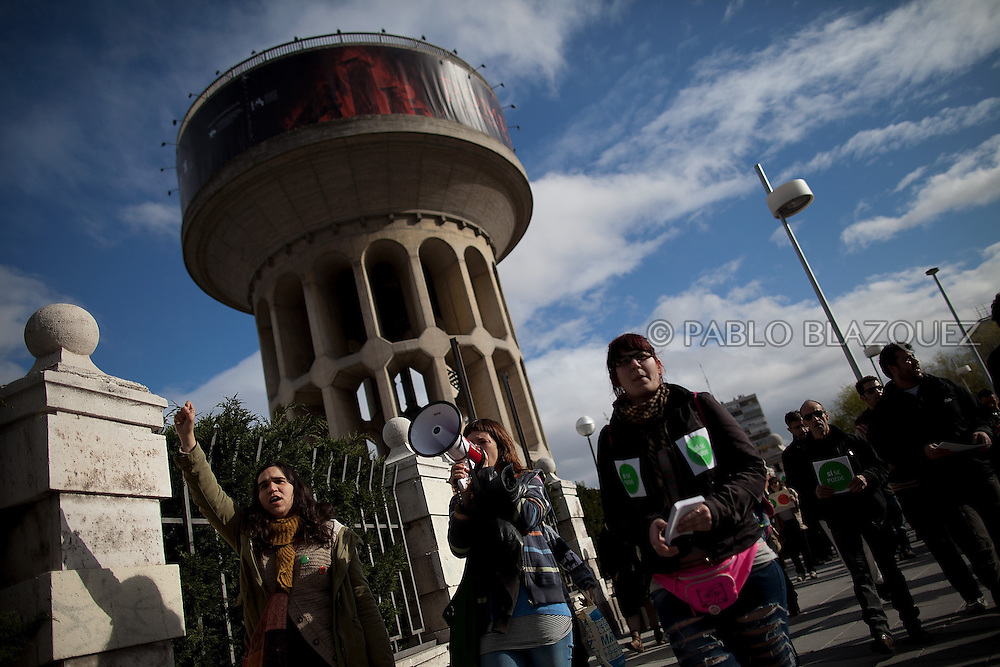 Anti eviction activists shout slogans on their way to an 'escrache' outside the house of PP deputy Beatriz Rodriguez Salmones on April12, 2013 in Madrid, Spain. The Mortgage Holders Platform (PAH) and other anti evictions organizations have been organizing 'escraches' for several weeks under the slogan 'There are lives at risk' to claim the vote for a Popular Legislative Initiative (ILP) to stop evictions and facilitate social rent, outside Popular Party deputies' houses and offices. 'Escraches' are a form of peaceful protest that were used in Argentine in 1995 to publically denounce pardoned members of the dictatorship for their crimes at their doorsteps.