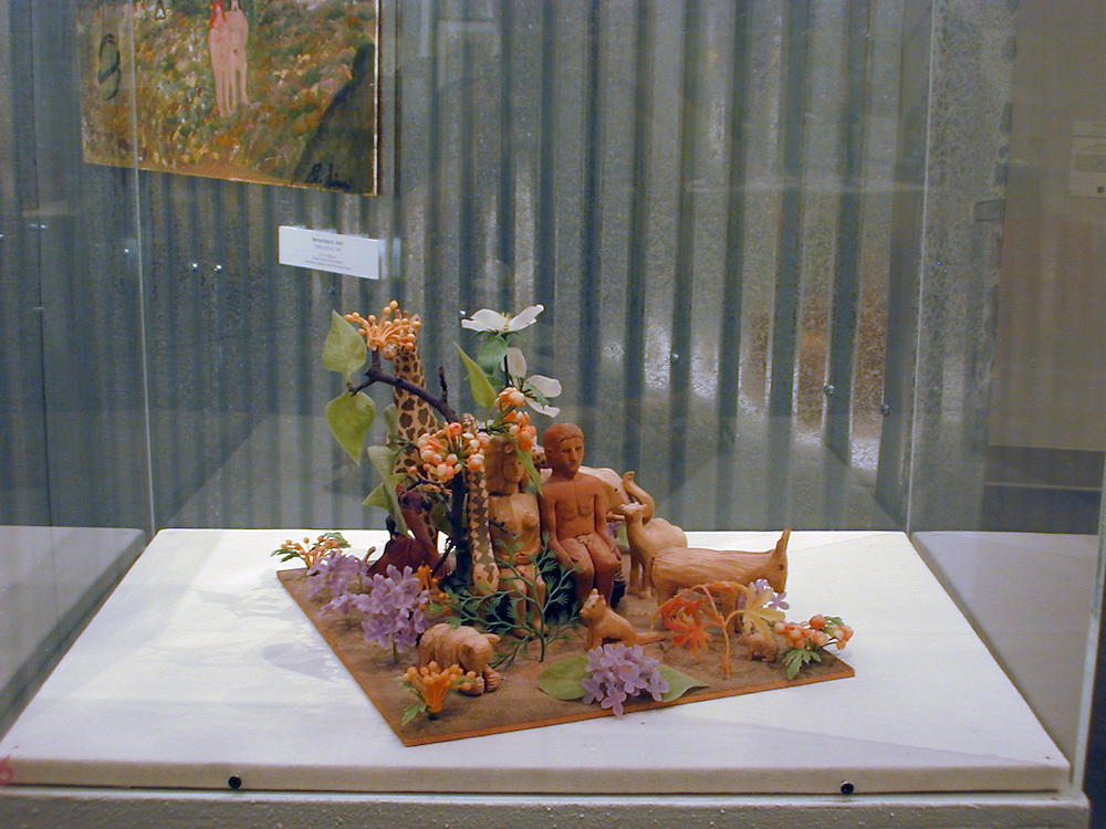 """Lawrence Stinson (1906-1998)<br /> """"Garden of Eden,"""" 1975<br /> Plywood, driftwood, plastic flowers and paint, 9.5 x 13 x 14<br /> Collection of Chuck and Jan Rosenak"""