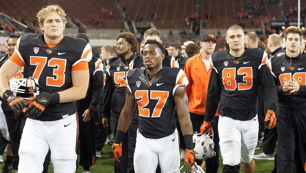 Oregon State players leave the field after defeating Weber State 26-7 in the 2015 season opener in Reser Stadium, in Corvallis, on Friday, Sept. 4, 2015.