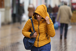 © Licensed to London News Pictures. 08/02/2015. Huddersfield, UK. A woman struggles in the driving wind and rain in Huddersfield, West Yorkshire, as the town is battered by Storm Imogen. The UK is set to see more bad weather with high winds and flood warnings in place causing chaos and disruption to travel. Photo credit : Ian Hinchliffe/LNP