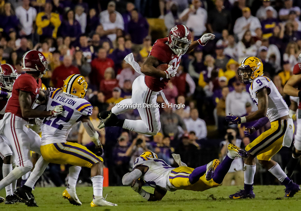 Nov 3, 2018; Baton Rouge, LA, USA; Alabama Crimson Tide tight end Irv Smith Jr. (82) leaps over LSU Tigers safety Todd Harris Jr. (33) during the third quarter at Tiger Stadium. Mandatory Credit: Derick E. Hingle-USA TODAY Sports
