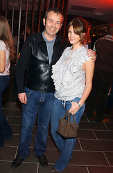 Club owner PIERS ADAM with his wife SOPHIE at the opening party for a new bowling alley All Star Lanes, at Victoria House, Bloomsbury Place, London on 19th January 2006.<br />