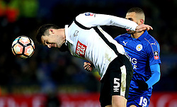 Jason Shackell of Derby County heads the ball away from Islam Slimani of Leicester City - Mandatory by-line: Robbie Stephenson/JMP - 08/02/2017 - FOOTBALL - King Power Stadium - Leicester, England - Leicester City v Derby County - Emirates FA Cup fourth round replay