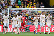 GOAL - Manchester United players celebrate with Manchester United Defender Chris Smalling 0-2, during the Premier League match between Watford and Manchester United at Vicarage Road, Watford, England on 15 September 2018.