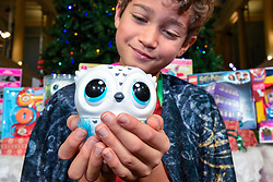 """© Licensed to London News Pictures. 13/11/2019. LONDON, UK. Xavier (aged 10) plays with an Owleez owl by Spin Master Toys at the preview of """"DreamToys"""", the official toys and games Christmas Preview, held at St Mary's Church in Marylebone.  Recognised as the countdown to Christmas, the Toy Retailer's Association, an independent panel of leading UK toy retailers, have selected the definitive and most authoritative list of which toys will be the hottest property this Christmas.  Photo credit: Stephen Chung/LNP"""