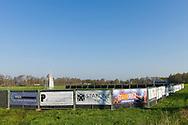 Nederland, Reek, 20160411<br /> Streekfeest in Reek, Noord-Brabant op 23, 26 en 27 april 2016.<br /> Elk jaar weer een feestje. Het terrein is al afgezet en een fake molen is in het weiland erbij gezet. <br /> <br /> Netherlands, Reek