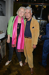 ARTEMIS COOPER and NICKY HASLAM at a dinner hosted by Lucy Yeomans and Amanada Foreman to celebrate the launch of the film Georgiana, Duchess of Devonshire held at sackville's, Sackville Street, London on 7th September 2015.
