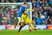 Ryan Jack (#8) of Rangers FC fouls Manu Morlanes (#28) of Villarreal CF during the Europa League group stage match between Rangers FC and Villareal CF at Ibrox, Glasgow, Scotland on 29 November 2018.