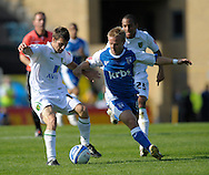 Picture by Ady Kerry/Focus Images Ltd.  .26/09/09.Gillingham's Danny Jackman challenges Norwich's Wes Hoolahan during their Coca-Cola League 1 game at the Priestfield Stadium, Gillingham, Kent.