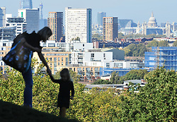 © Licensed to London News Pictures. 09/10/2018<br /> GREENWICH, UK.<br /> A view across London from Greenwich Park.<br /> People out and about in an autumnal Greenwich Park on a sunny October day in London and the South East with temperatures at 19C with blue sky. <br /> Photo credit: Grant Falvey/LNP