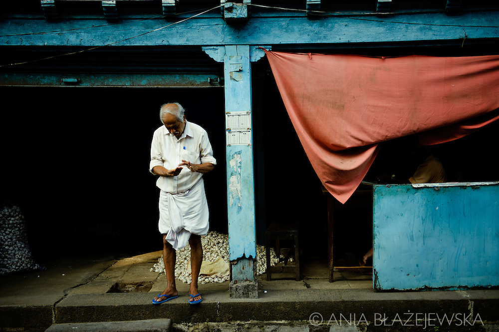 India, Kochi. Trader of Bazaar Road.<br />