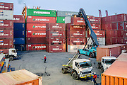 Containers are loaded onto trucks and driven to the ship before a crane loads them aboard. The Port of Jakarta also known as Tanjung Priok Port is the largest Indonesian seaport and one of the largest seaports in the Java Sea basin, with an annual traffic capacity of around 45 million tonnes of cargo and 4,000,000 TEU's.This port is located in Tanjung Priok, North Jakarta.