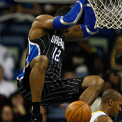January 12, 2011; New Orleans, LA, USA; Orlando Magic center Dwight Howard (12) dunks against the New Orleans Hornets during the first quarter at the New Orleans Arena.   Mandatory Credit: Derick E. Hingle