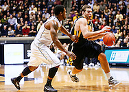 WEST LAFAYETTE, IN - JANUARY 27: Eric May #25 of the Iowa Hawkeyes dribbles against Terone Johnson #0 of the Purdue Boilermakers at Mackey Arena on January 27, 2013 in West Lafayette, Indiana. Purdue defeated Iowa 65-62 in overtime. (Photo by Michael Hickey/Getty Images) *** Local Caption *** Eric May; Terone Johnson