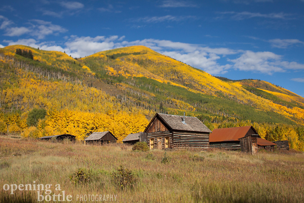 Tilt-shift landscape of the Ashcroft Ghost Town and aspen trees in full autumn color, south of Aspen, Colorado.