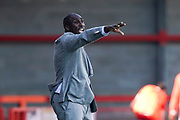 Macclesfield Town manager Sol Campbell signals to his team during the EFL Sky Bet League 2 match between Crawley Town and Macclesfield Town at The People's Pension Stadium, Crawley, England on 23 February 2019.