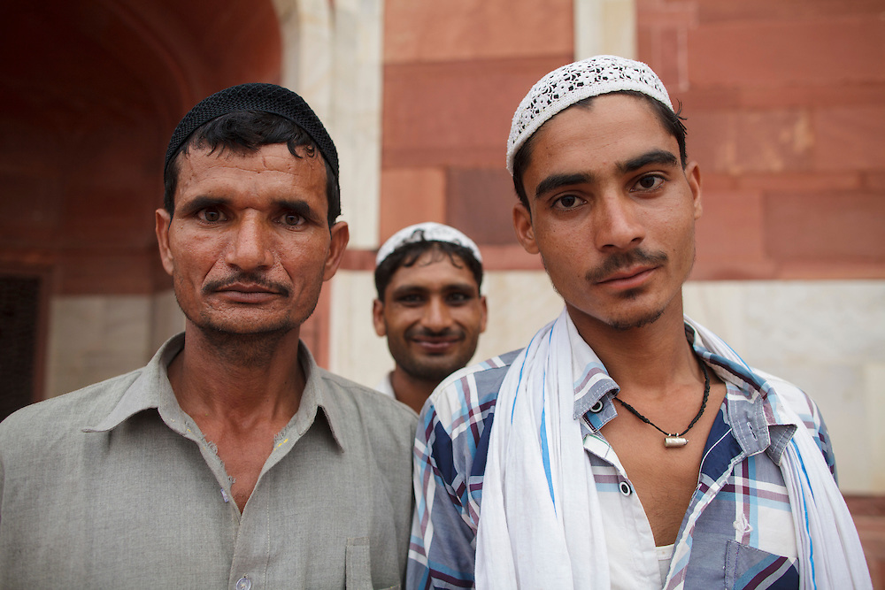 Muslim men posing for a photo at Humayun's Tomb in Delhi, India