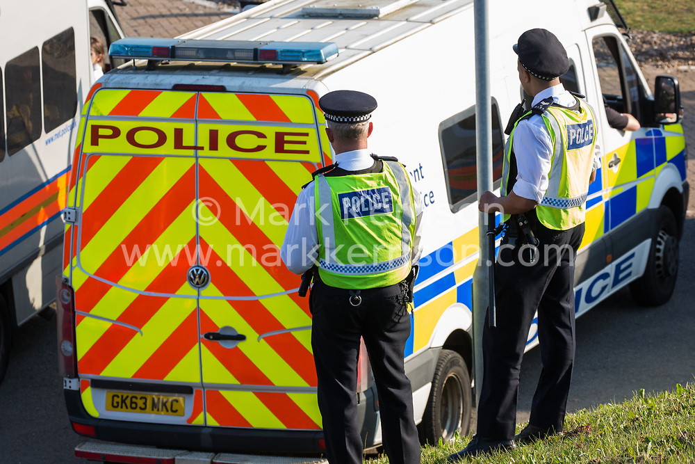 London, UK. 19th April, 2019. Police vehicles alongside the main motorway approach to Heathrow airport. A large policing operation was put in place in and around the airport in preparation for expected protests by climate change activists from Extinction Rebellion. Only a very small symbolic protest by teenage activists from Extinction Rebellion Youth took place, dispersed by police officers under threat of arrest.