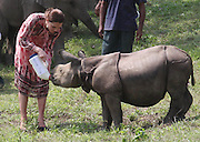 ASSAM (INDIA), April 13, 2016 <br /> <br /> Kate Middleton, wife of British Prince William, feeds a rhino at the Centre for Wildlife Rehabilitation at Panbari reserve forest in Kaziranga, Indian northeastern state of Assam, on  April 13, 2016. British Prince William and his wife Kate Middleton on Wednesday got a taste of India's wildlife by visiting the Kaziranga National Park in the northeastern state of Assam, home to two-thirds of the world's Indian one-horned rhinos.<br /> ©Exclusivepix Media
