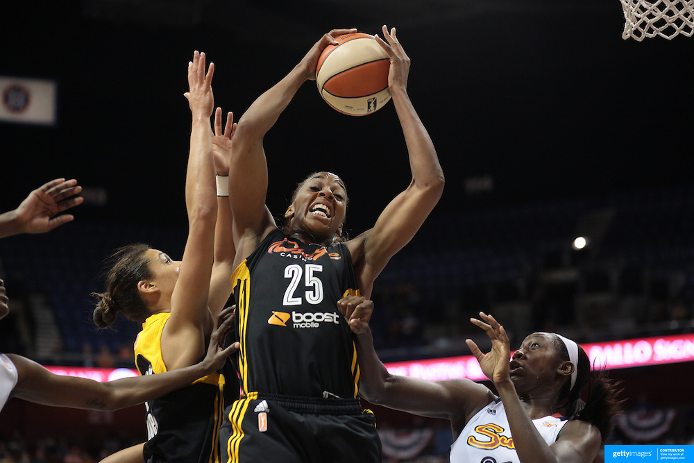 Glory Johnson, Tulsa Shock, rebounds during the Connecticut Sun V Tulsa Shock WNBA regular game at Mohegan Sun Arena, Uncasville, Connecticut, USA. 2nd July 2013. Photo Tim Clayton