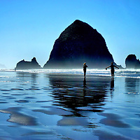 Barefoot in Pacific Ocean Next to Haystack Rock at Cannon Beach, Oregon<br /> On Oregon&rsquo;s Pacific coast is the fascinating Haystack Rock. The giant monolith rises 235 feet from the sands of Cannon Beach. It is accessible from shore during low tide. At high tide, however, be careful: many people have been stranded by fast rising water and had to be rescued. Next to it are two smaller yet impressive rock towers called the Needles. This sandy beach and shallow, warm water are perfect for a barefoot stroll with your best friend.