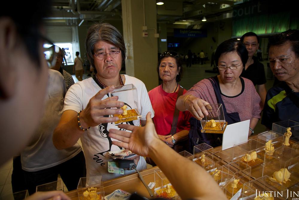 Punters buy gold ornaments at the Hong Kong Jockey Club's Shatin Racecourse.