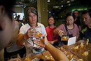 Punters buy gold ornaments at the Hong Kong Jockey Club's Shatin Racecourse.