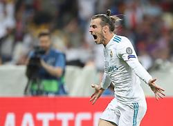 May 26, 2018 - Kiev, Ukraine - Gareth Bale of Real Madrid celebrates scoring his side's second goal during the UEFA Champions League Final between Real Madrid and Liverpool at NSC Olimpiyskiy Stadium on May 26, 2018 in Kiev, Ukraine. (Credit Image: © Raddad Jebarah/NurPhoto via ZUMA Press)