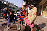 India, National Capital Territory of Delhi Homeless Children take water from a tap in the street