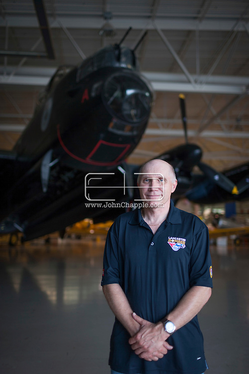 July 30, 2014. Hamilton, Ontario, Canada. The Canadian Warplane Heritage Museum will be flying their prized Avro Lancaster to England to join the only other airworthy Lancaster in the world, owned and operated by the Royal Air Force's renowned Battle of Britain Memorial Flight. Pictured is flight crew member Randy Straughan.<br /> .<br /> Photo Copyright John Chapple / www.JohnChapple.com