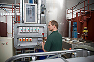 A worker at EcoTech, a company based in Bamber Bridge, Lancashire, working at 10,000-litre capacity separating system which produces biodiesel at his company's plant. The firm takes used commercial vegetable oil and separates it into glycerol and biodiesel, the latter of which can be used in domestic and commercial vehicles. EcoTech was established three years ago and now produces around 7000 litres per week.