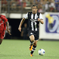 Newcastle United Defender Sanchez Jose Enrique (3) dribbles the ball past Orlando City Lions Midfielder Erik Ustruck (8) during an International Friendly soccer match between English Premier League team Newcastle United and the Orlando City Lions of the United Soccer League, at the Florida Citrus Bowl on Saturday, July 23, 2011 in Orlando, Florida. Orlando won the match 1-0. (AP Photo/Alex Menendez)