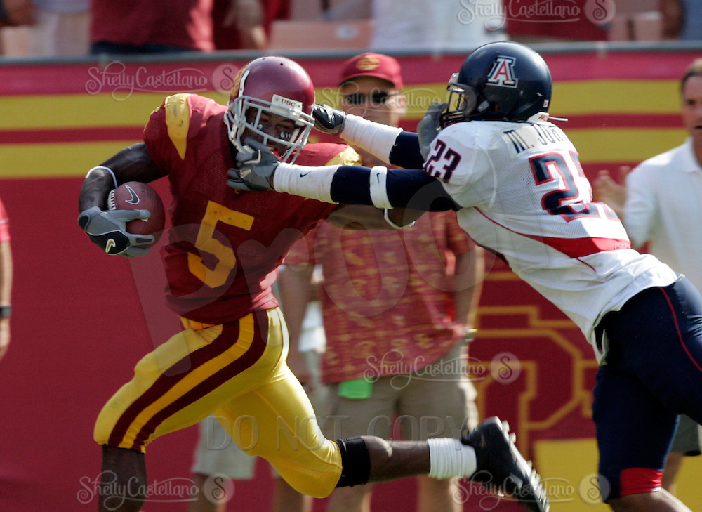 8 October 2005:  USC Trojans #5 Reggie Bush fights off Michael Johnson during a 42-21 win over the Arizona Wildcats at the Los Angeles Memorial Coliseum. NCAA Pac-10 College Football day game.