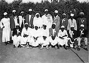 Men gather after Eid prayers.