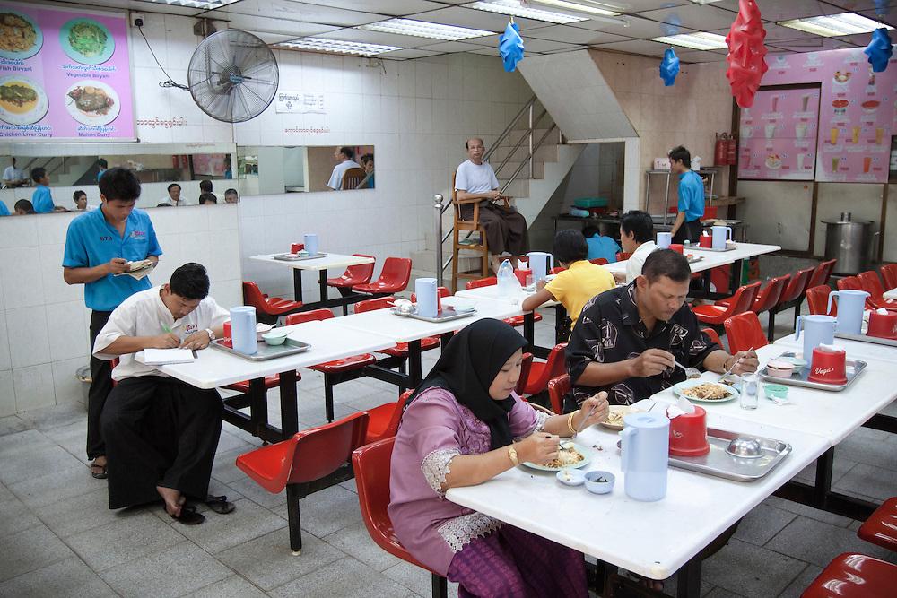Supper time in a popular Indian biryani restaurant in central Yangon in Myanmar.
