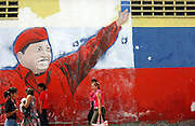 Caracas, Venezuela<br />Outside a factory in Catia district a large murals shows support for Venezuelan president Hugo Chavez. Large murals depicting Chavez are sprouting up in Caracas, part of a growing cult of personality centred around Chavez.