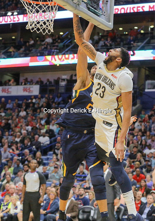 Mar 11, 2018; New Orleans, LA, USA; New Orleans Pelicans forward Anthony Davis (23) draws a foul with a basket past Utah Jazz center Rudy Gobert (27) during the first half at the Smoothie King Center. Mandatory Credit: Derick E. Hingle-USA TODAY Sports