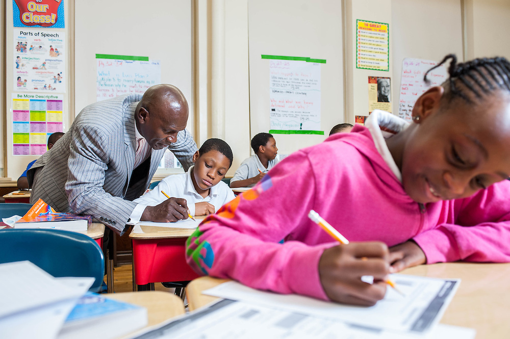 Mass Housing's George Ovins teaching students through the S.T.A.R.R. mentoring program at the Martin Luther King School.