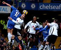 Photo: Ed Godden.<br />Chelsea v Fulham. The Barclays Premiership. 30/12/2006.<br />Chelsea's Michael Ballack (L), leaps high above Carlos Bocanegra.