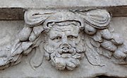 Mask and garland frieze from the Portico of Tiberius on the Southern portico of the Agora, 1st century AD, Aphrodisias, Aydin, Turkey. The Sculpture School at Aphrodisias was an important producer of carved marble sarcophagi and friezes from the 1st century BC until the 6th century AD. The Portico of Tiberius was built under the reign of Tiberius and has many examples of mask and garland friezes, consisting of the heads of gods, goddesses, theatrical characters, mythological figures or masks, each with a distinct facial expression, between hanging garlands of leaves, fruit and flowers. This example shows a weary-looking bearded man. Aphrodisias was a small ancient Greek city in Caria near the modern-day town of Geyre. It was named after Aphrodite, the Greek goddess of love, who had here her unique cult image, the Aphrodite of Aphrodisias. The city suffered major earthquakes in the 4th and 7th centuries which destroyed most of the ancient structures. Picture by Manuel Cohen