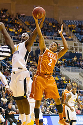Jan 20, 2016; Morgantown, WV, USA; Texas Longhorns guard Demarcus Holland (2) and West Virginia Mountaineers forward Devin Williams (41) jump for a rebound during the first half at the WVU Coliseum. Mandatory Credit: Ben Queen-USA TODAY Sports