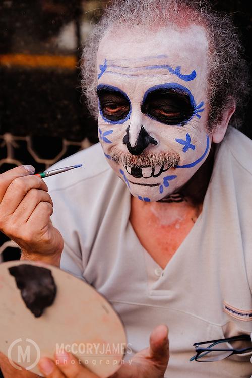 Painting his face for Dia de los Muertos