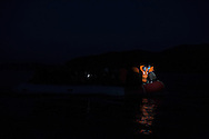 Refugees from Afghanistan and Syria are spotted by volunteer helpers as they reach at dusk the shores of Lesbos near Skala Sikaminias, Greece on 05<br />