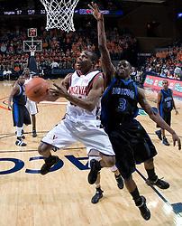 Virginia Cavaliers point guard Sean Singletary (44) shoots around Longwood Lancers forward Kirk Williams (3).  The Virginia Cavaliers Men's Basketball Team defeated Longwood University 90-49 at the John Paul Jones Arena in Charlottesville, VA on February 13, 2007.