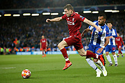 Liverpool midfielder James Milner (7) gets passed FC Porto forward Fernando Andrade (37) during the Champions League Quarter-Final Leg 1 of 2 match between Liverpool and FC Porto at Anfield, Liverpool, England on 9 April 2019.