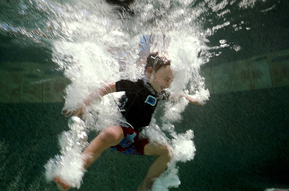 Robert Burke, 4, makes a splash into a swimming pool in Redding, California.  Northern California is a vacation destination that is packed with outdoor activities.  Fishing, swimming, hiking, boating and all outdoor activities are enjoyed in the area.  Redding is the core of activity and within an hour you can be skiing, climbing a volcano or swimming in a lake.